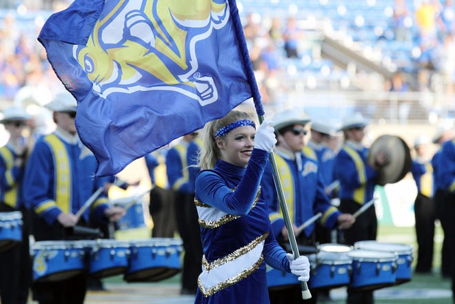 A member of the Pride of the Dakotas Marching Band performs before the SDSU matchup against Montana State Saturday in Brookings. Jason Salzman For The Argus Leader