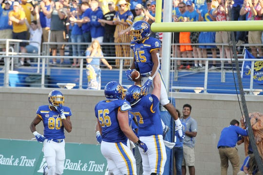 South dakota State's Cade Johnson (15) gets hoisted into the air by Wes Genant after scoring a touchdown during the second quarter of the Jackrabbits' matchup against Montana State Saturday night at Dana J. Dykhouse Stadium in Brookings. Jason Salzman For The Argus Leader