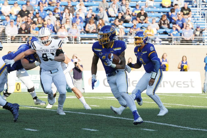 South Dakota State's Isaac Wallace runs for a first down during the first quarter of the Jackrabbits' matchup against the Montana State Saturday night at Dana J. Dykhouse Stadium in Brookings. Jason Salzman For The Argus Leader
