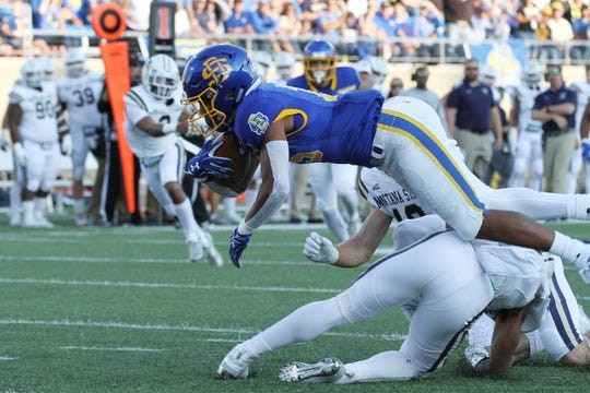 South Dakota State's Cade Johnson (15) leaps for extra yards after a catch during the first quarter of the Jackrabbits' matchup against Montana State Saturday night at Dana J. Dykhouse Stadium in Brookings. Jason Salzman For The Argus Leader