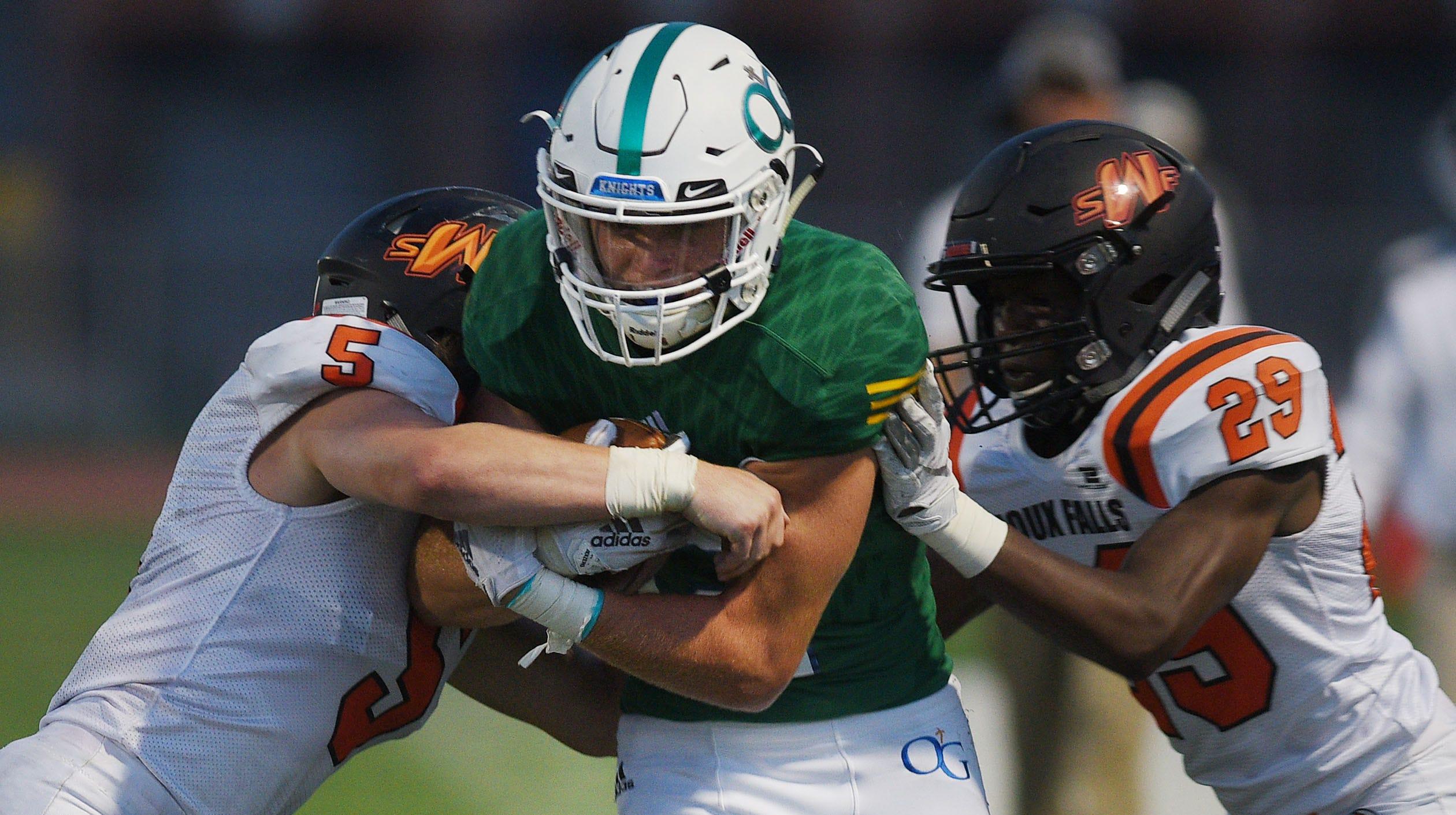 O'Gorman's Canyon Bauer is tackled by Washington defense during the 40th Bob Burns Dakota Bowl Saturday, Sept 8, at Howard Wood Field in Sioux Falls.