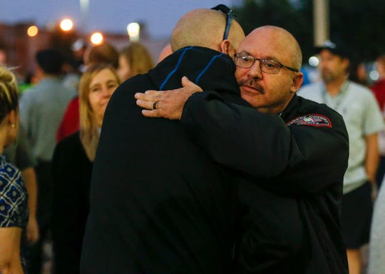 Retired Springfield Police Officer Aaron Pearson offers his condolences to Sheriff Jim Arnott during a candlelight vigil in honor of deputy Aaron Roberts on Saturday, Sept. 8, 2018. Deputy Roberts died after his patrol car was washed off the roadway by rushing water during a storm north of Fair Grove.