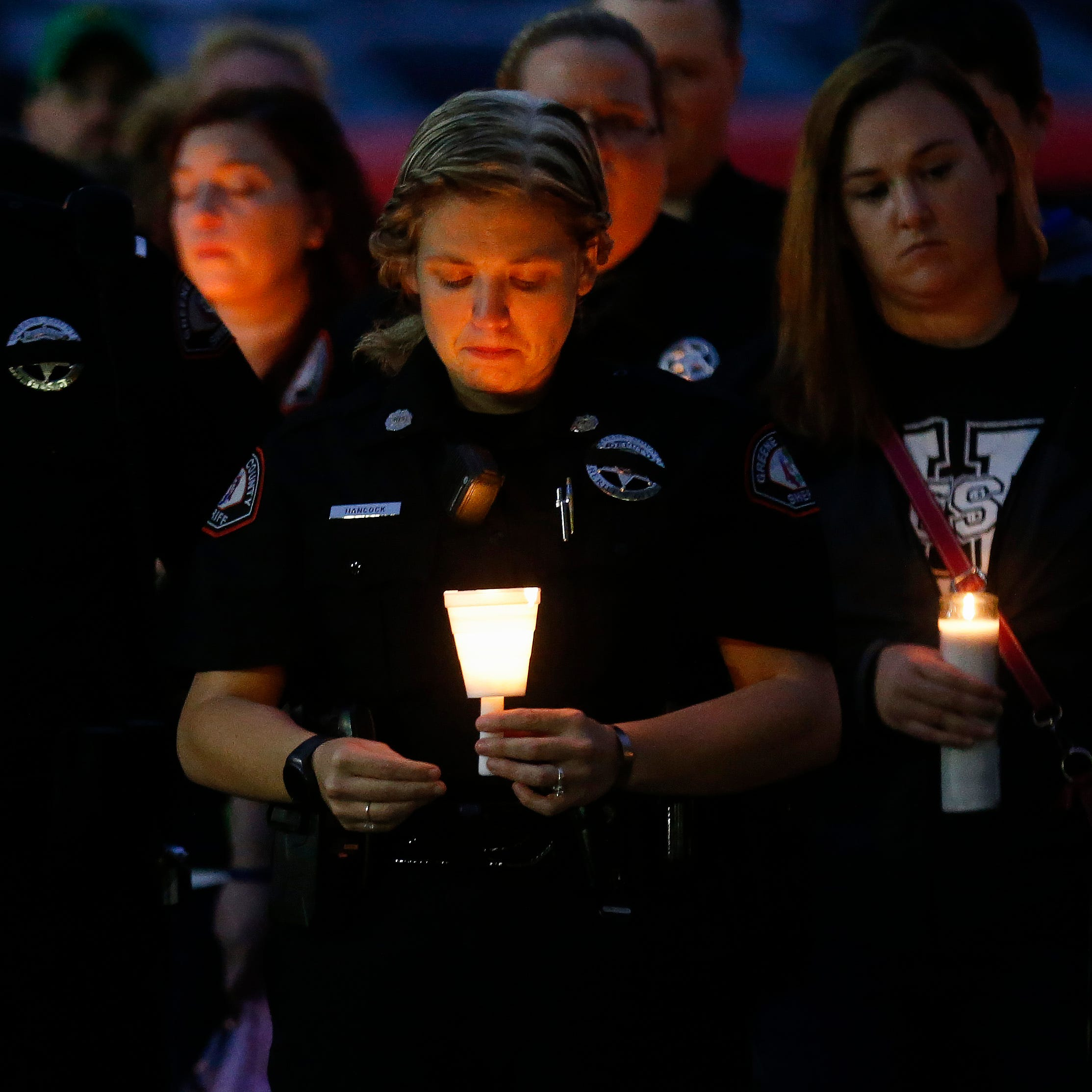 Hundreds attend candlelight vigil for Deputy Aaron Roberts
