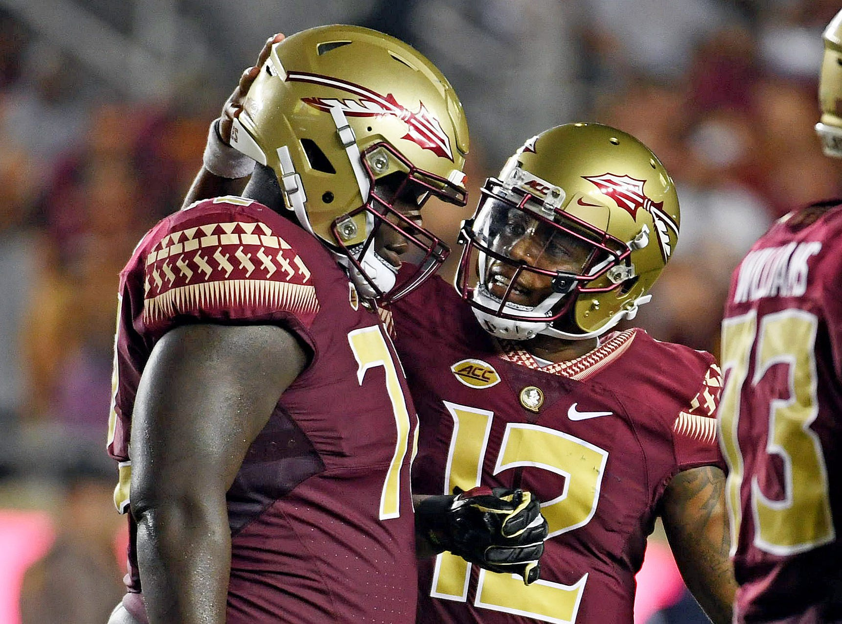 Florida State Seminoles quarterback Deondre Francois (12) talks to offensive lineman Mike Arnold (72) after a play in the first half against the Samford Bulldogs at Doak Campbell Stadium.