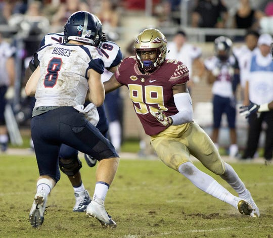 Samford Bulldogs quarterback Devlin Hodges (8) is pressured by Florida State Seminoles defensive end Brian Burns (99) during the second half of play as the Florida State Seminoles host the Samford Bulldogs at Doak Campbell Stadium. Florida State won 36-26.