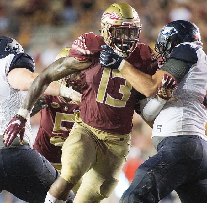 Florida State Seminoles defensive end Joshua Kaindoh (13) brings the pressure during the second half of play as the Florida State Seminoles host the Samford Bulldogs at Doak Campbell Stadium. Florida State won 36-26.
