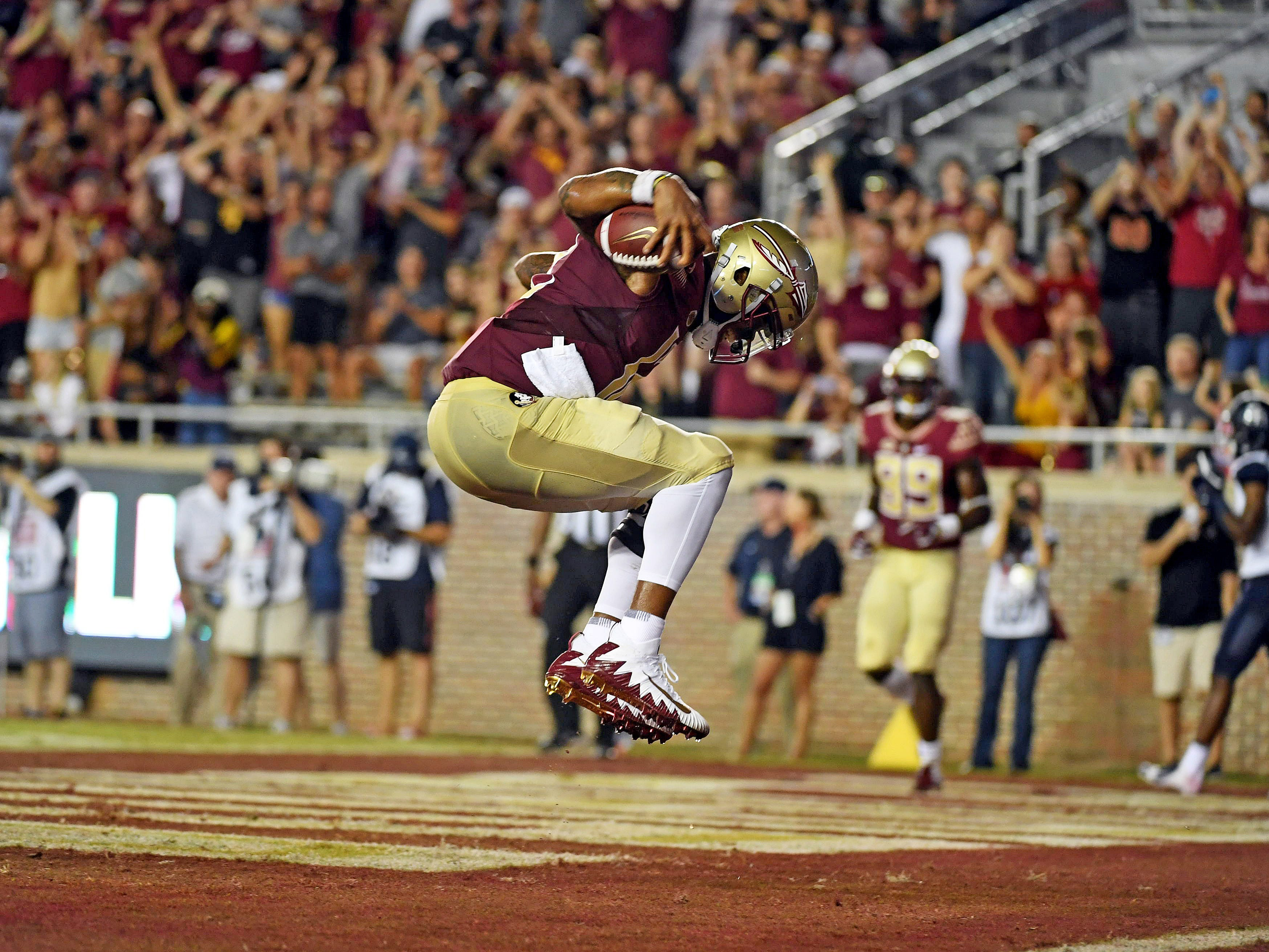 Florida State Seminoles quarterback Deondre Francois (12) celebrates after a touchdown in the first half against the Samford Bulldogs at Doak Campbell Stadium. Mandatory