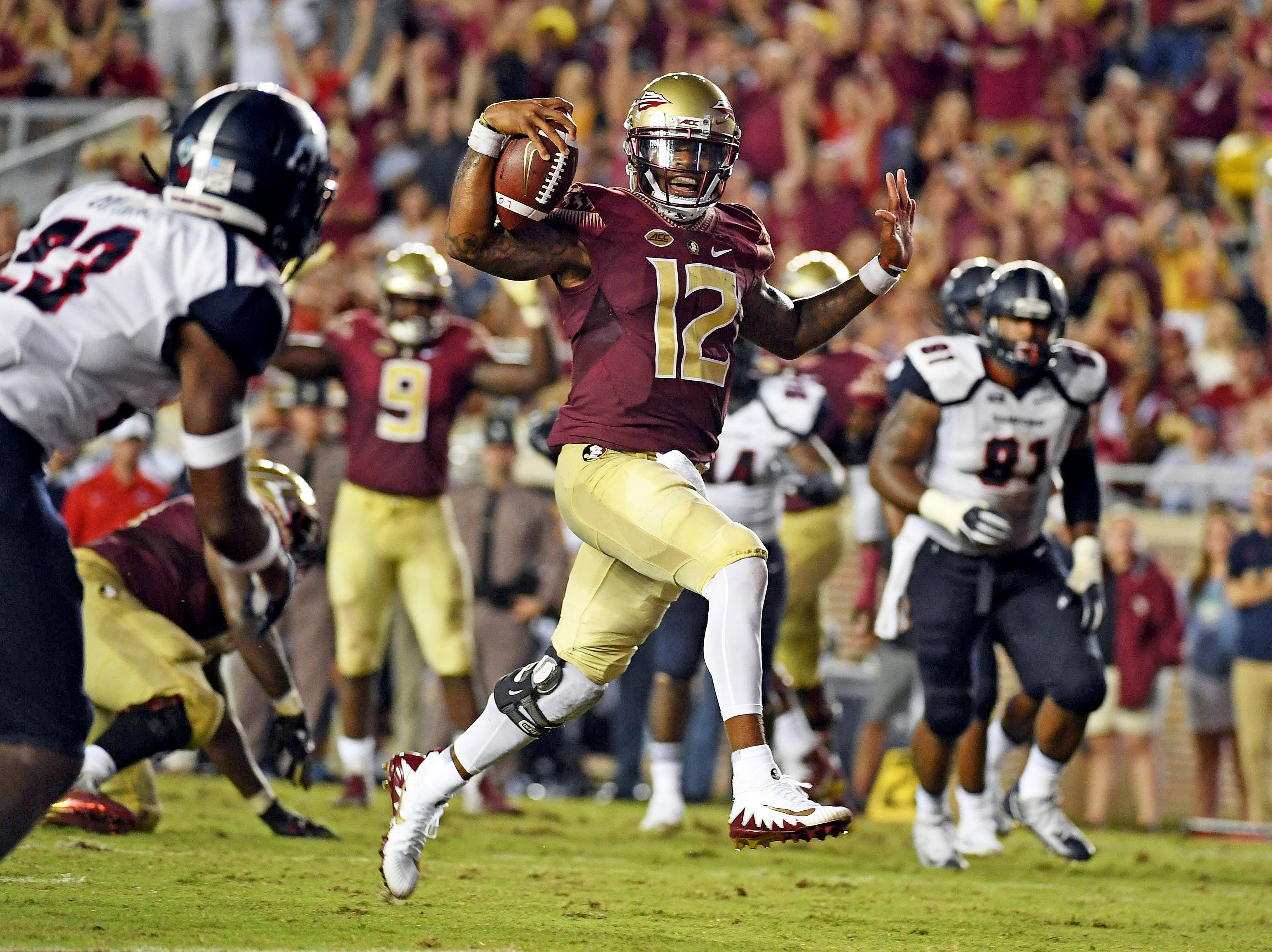 Florida State Seminoles quarterback Deondre Francois (12) runs for a touchdown in the first half against the Samford Bulldogs at Doak Campbell Stadium.