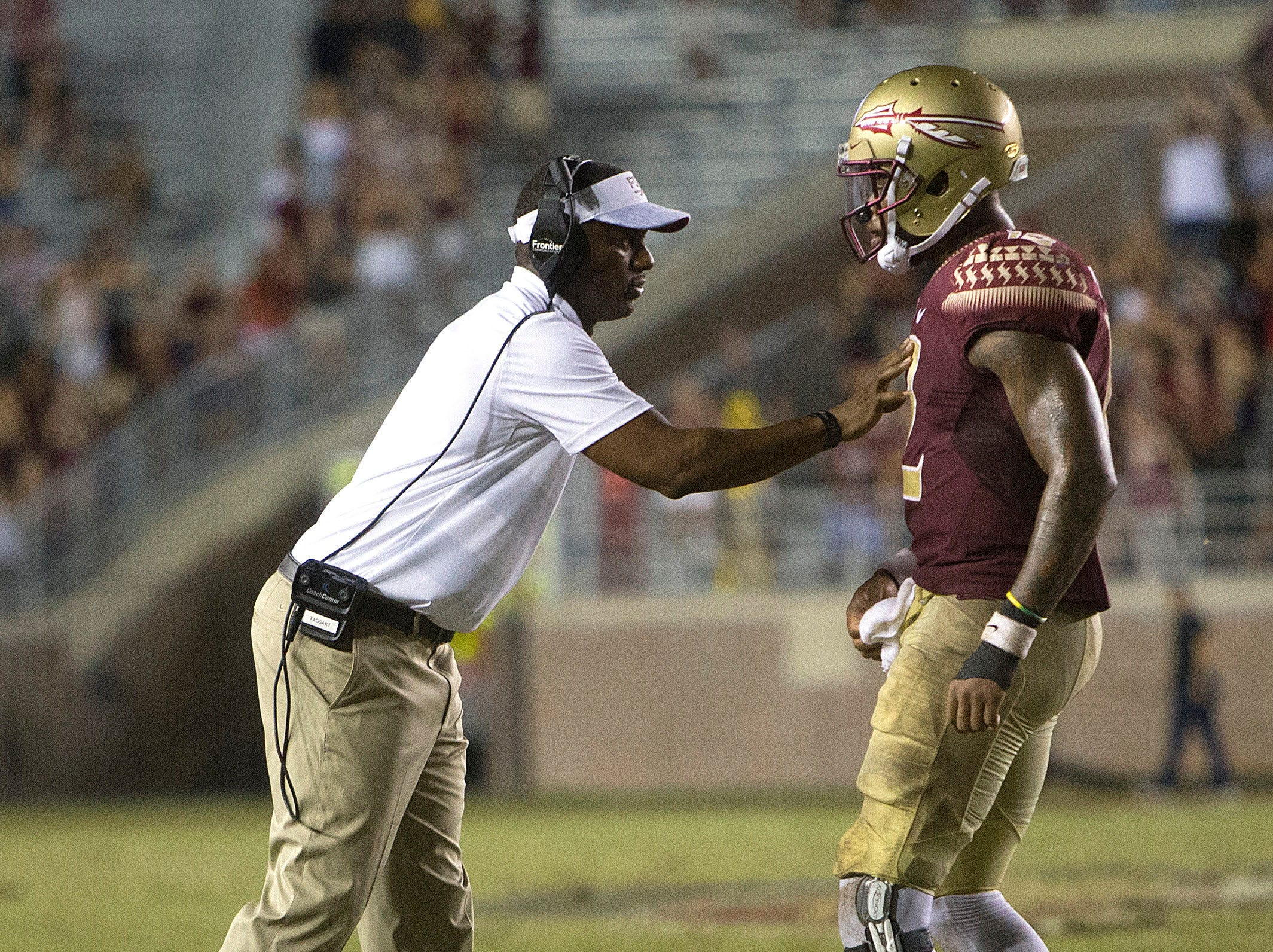 Florida State Seminoles head coach Willie Taggart talks to Florida State Seminoles quarterback Deondre Francois (12) during the second half of play as the Florida State Seminoles host the Samford Bulldogs at Doak Campbell Stadium. Florida State won 36-26.