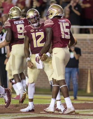 Florida State Seminoles quarterback Deondre Francois (12) celebrates a first quarter touchdown with wide receiver Tamorrion Terry (15) as the Florida State Seminoles host the Samford Bulldogs at Doak Campbell Stadium.