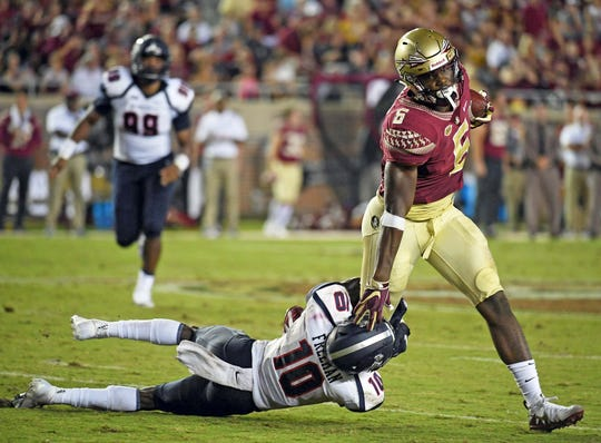 Florida State Seminoles tight end Tre' McKitty (6) runs past Samford Bulldogs defensive back Koi Freeman (10) during the first half at Doak Campbell Stadium.