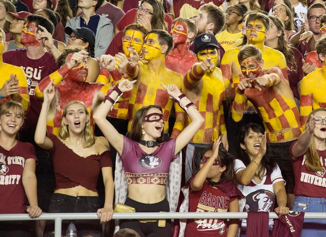 Fans cheer as the Florida State Seminoles host the Samford Bulldogs at Doak Campbell Stadium.