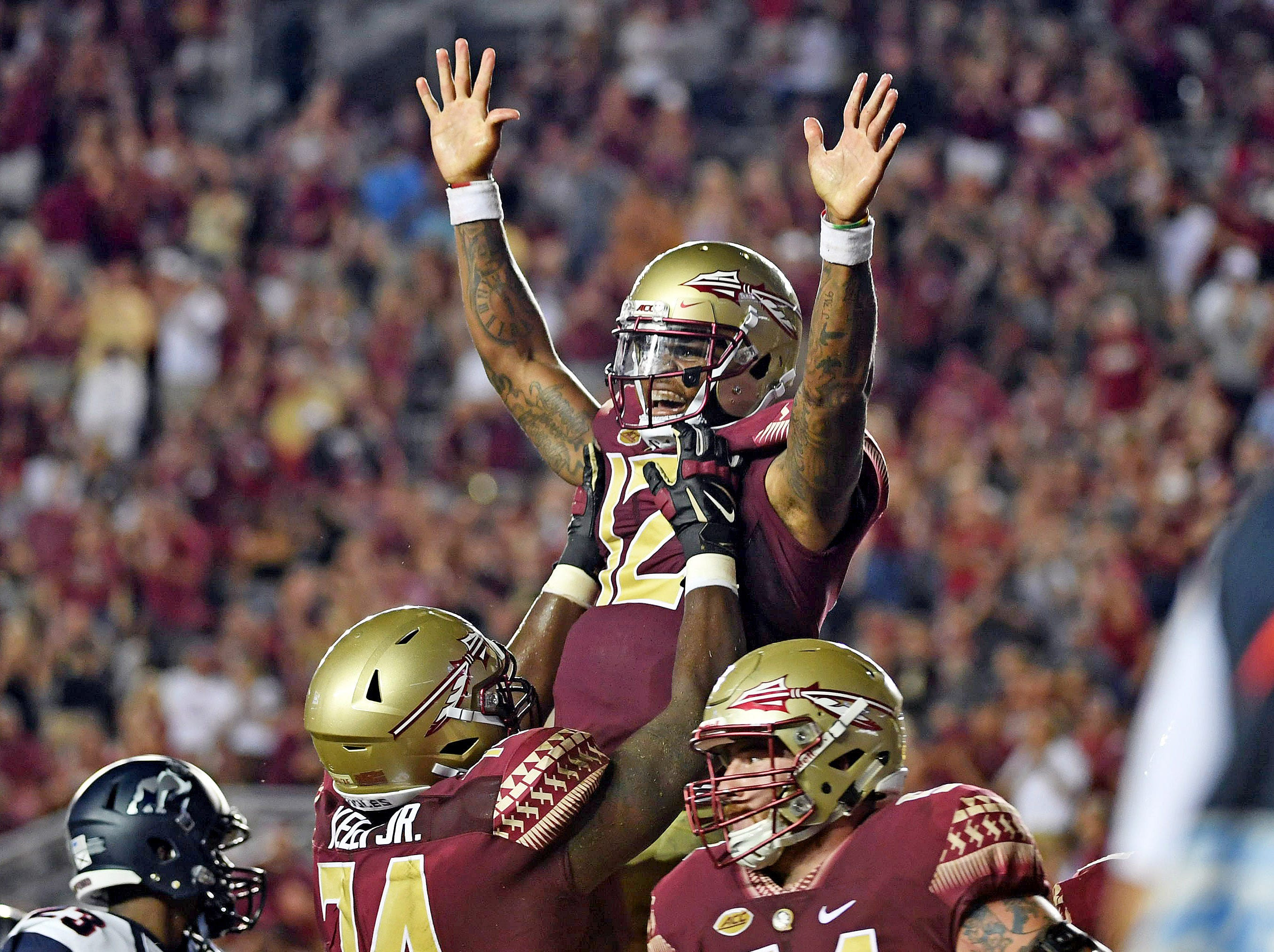 Florida State Seminoles quarterback Deondre Francois (12) celebrates after a touchdown with offensive lineman Derrick Kelly II (74) in the first half against the Samford Bulldogs at Doak Campbell Stadium.