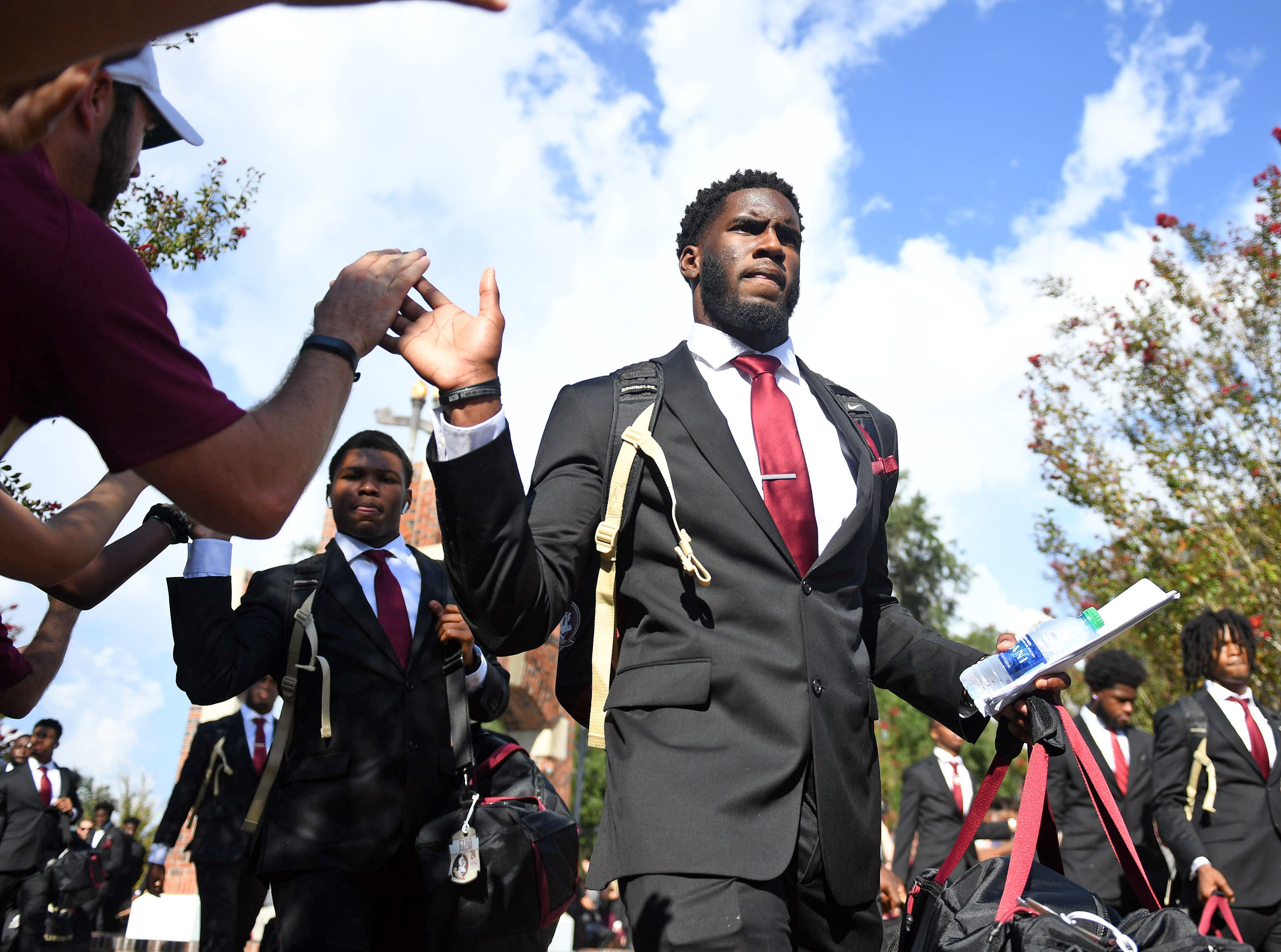 Florida State Seminoles defensive end Brian Burns (middle) enters the stadium prior to a game against the Samford Bulldogs at Doak Campbell Stadium.