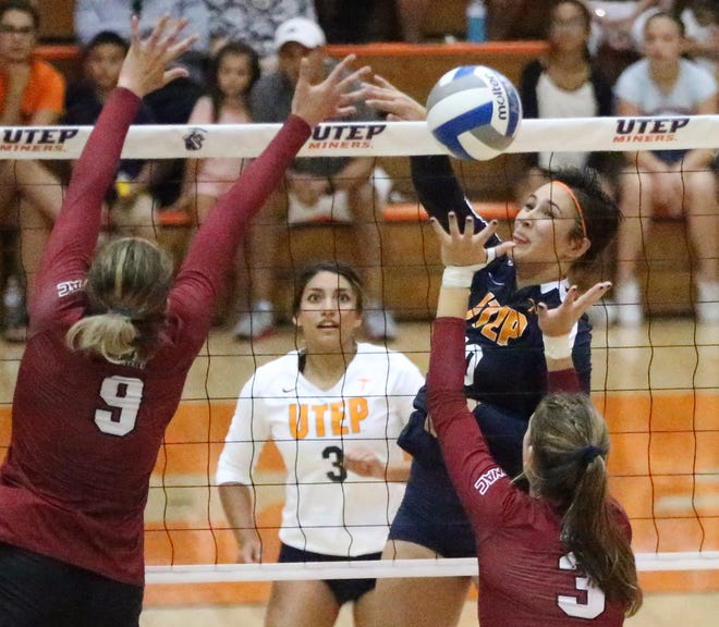 UTEP's Briana Arellano fires past Julianna Salanoa, 9, and Ashley Anselmo of NMSU on Sunday in Memorial Gym. The Miners lost to the Aggies in three sets.