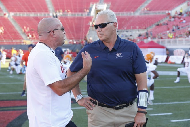 UTEP head football coach Dana Dimel, right.