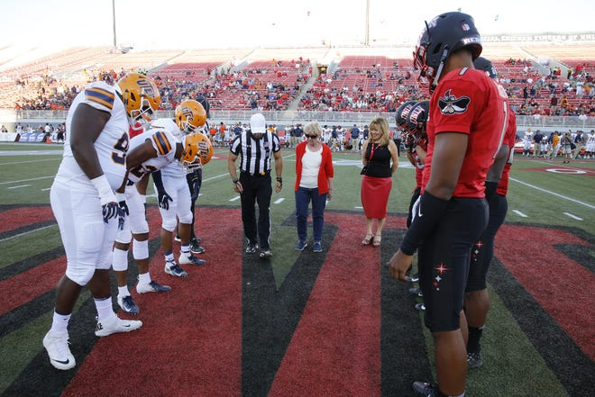 UTEP prepares to take the field against UNLV earlier this season at Sam Boyd Stadium.
