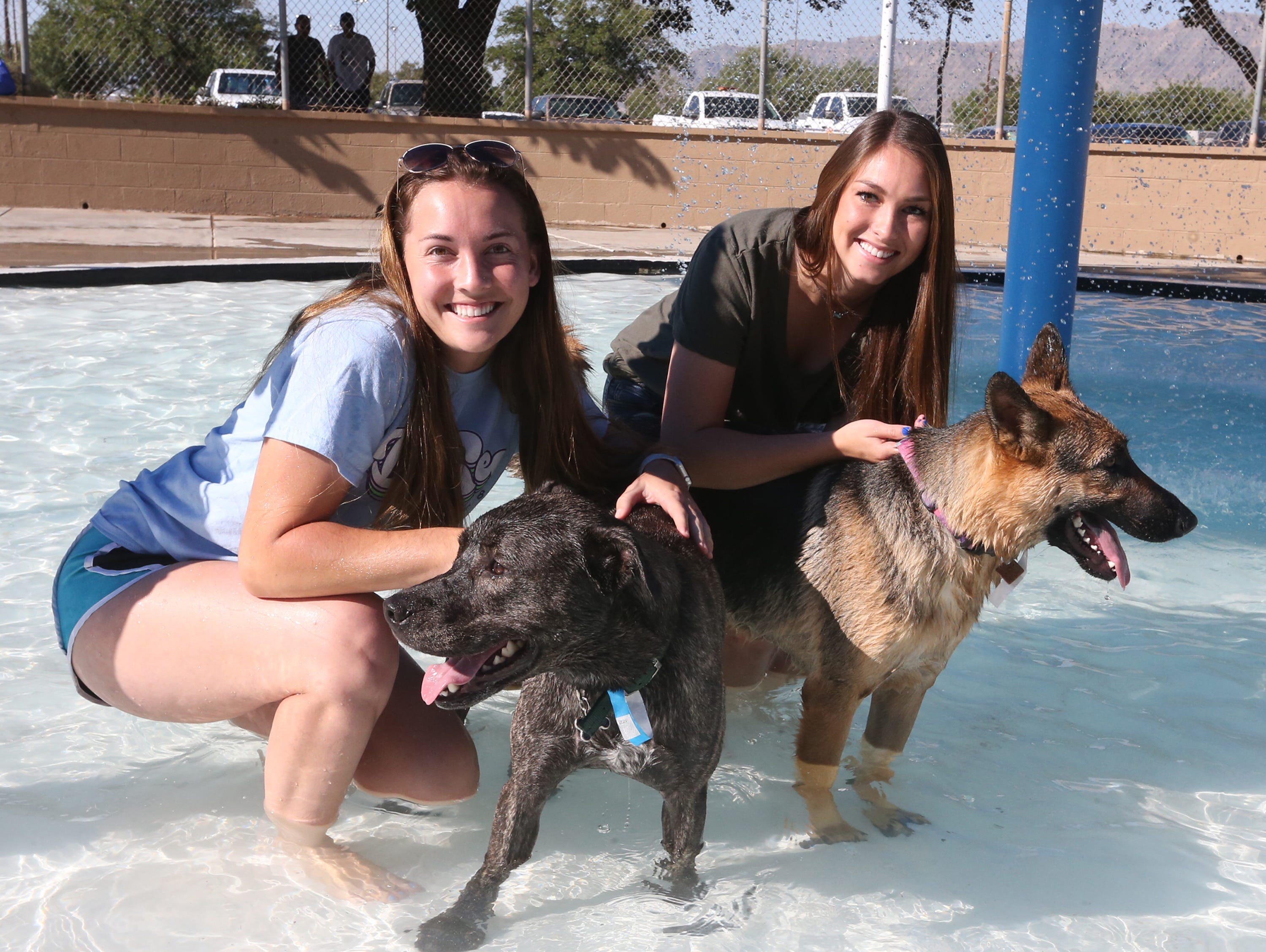 NMSU students Janea Eberly, left, and Marissa Alexander with their dogs Sunday.