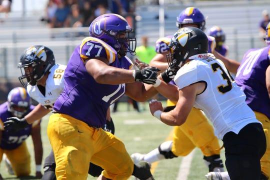Offensive tackle Tavita Sagapolu protects the Cal Lutheran University quarterback in Saturday's season-opening 24-8 win over visiting Pacific Lutheran University at Rolland Stadium.