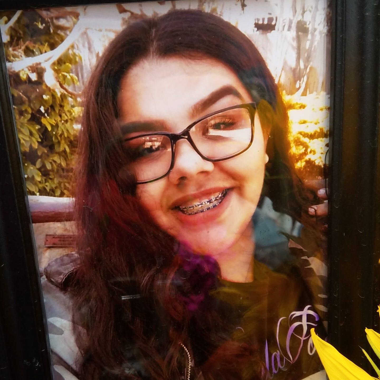 A photograph of Karissa Serrato, 20, of Port Hueneme, was left at a roadside memorial near a fatal crash in Oxnard.