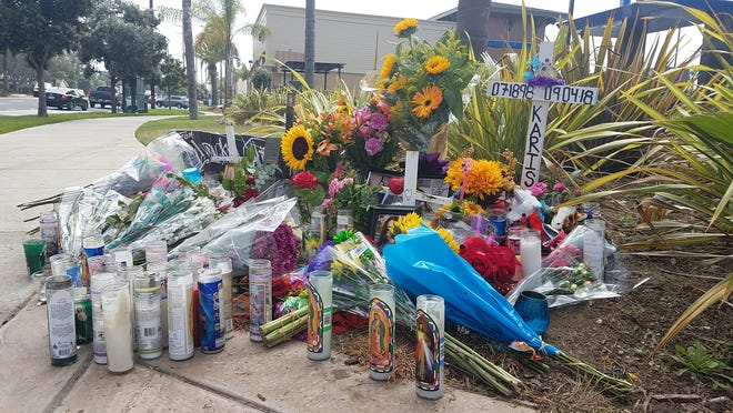 Days after a car crash killed two young adults in Oxnard, the corner of Wooley Road and Victoria Avenue features a memorial honoring the deceased victims with candles, flowers, photographs and messages from loved ones.