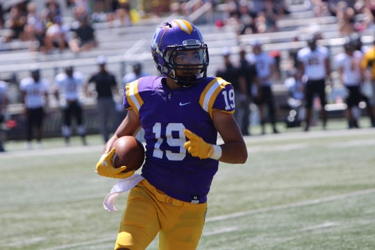 Receiver Kanoa Iwasaki finds room to run in the Cal Lutheran University football team's 24-8 season-opening win over visiting Pacific Lutheran University on Saturday afternoon at Rolland Stadium.