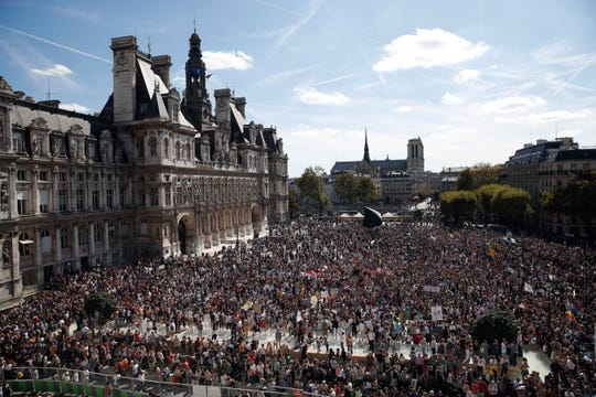 Thousands of people gather Saturday in Paris as part of a global day of protest ahead of a climate action summit this month in San Francisco.