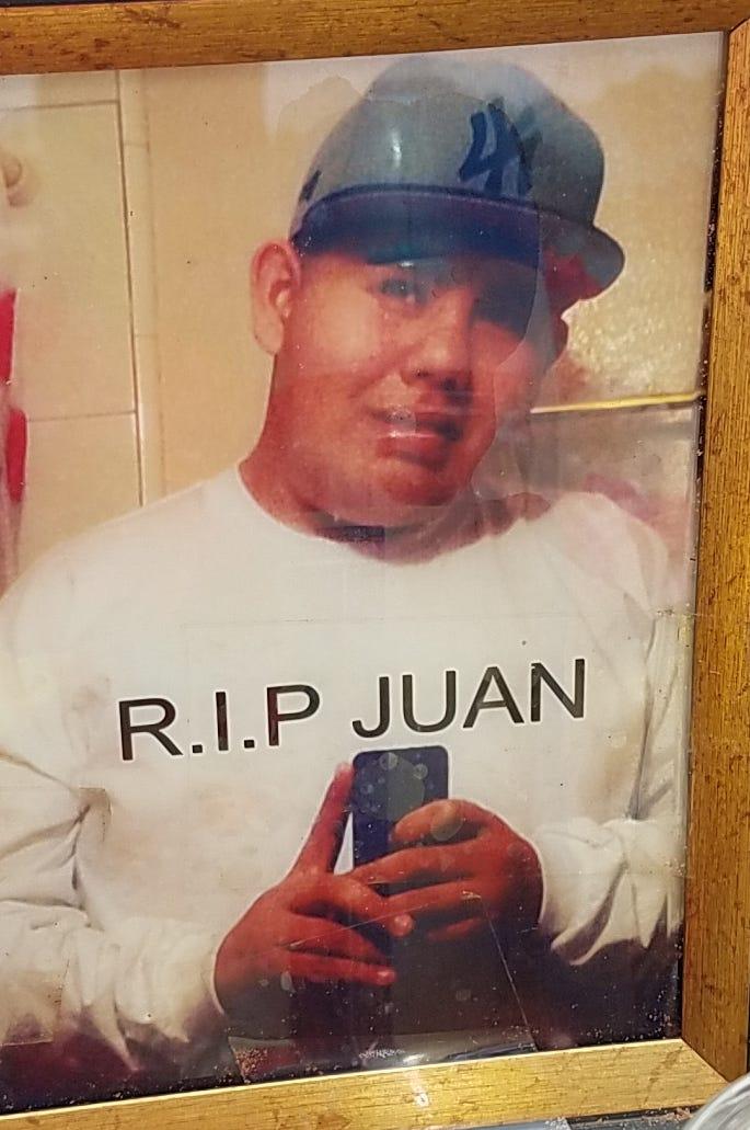 A photo of Juan Cruz, 19, of Oxnard, was left at a roadside memorial near a fatal crash at Wooley Road and Victoria Avenue.