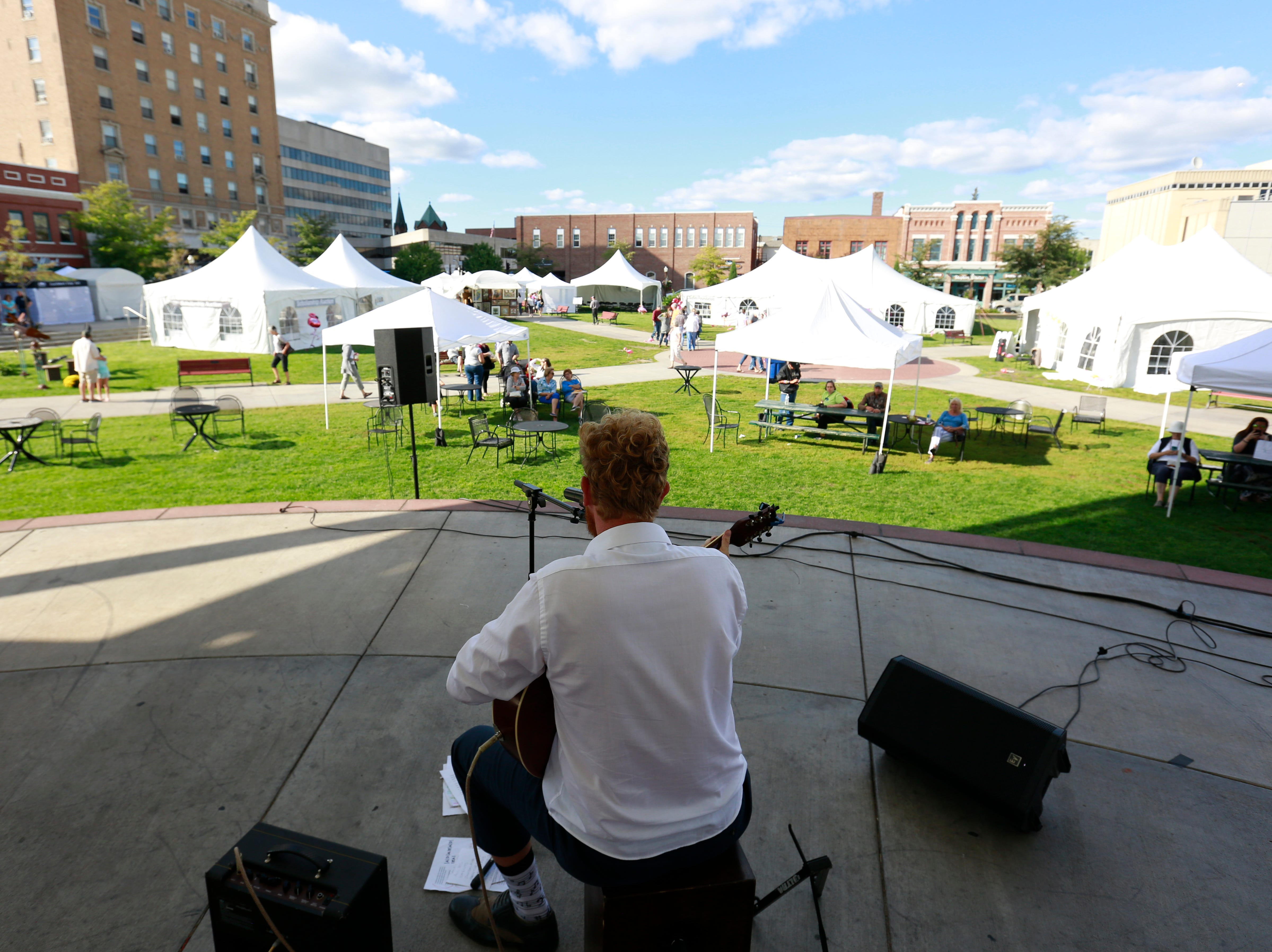 A musician performs on the stage in The 400 Block during Wausau Festival of Arts event held Saturday, Sept. 8, 2018, in downtoown Wausau, Wis. T'xer Zhon Kha/USA TODAY NETWORK-Wisconsin