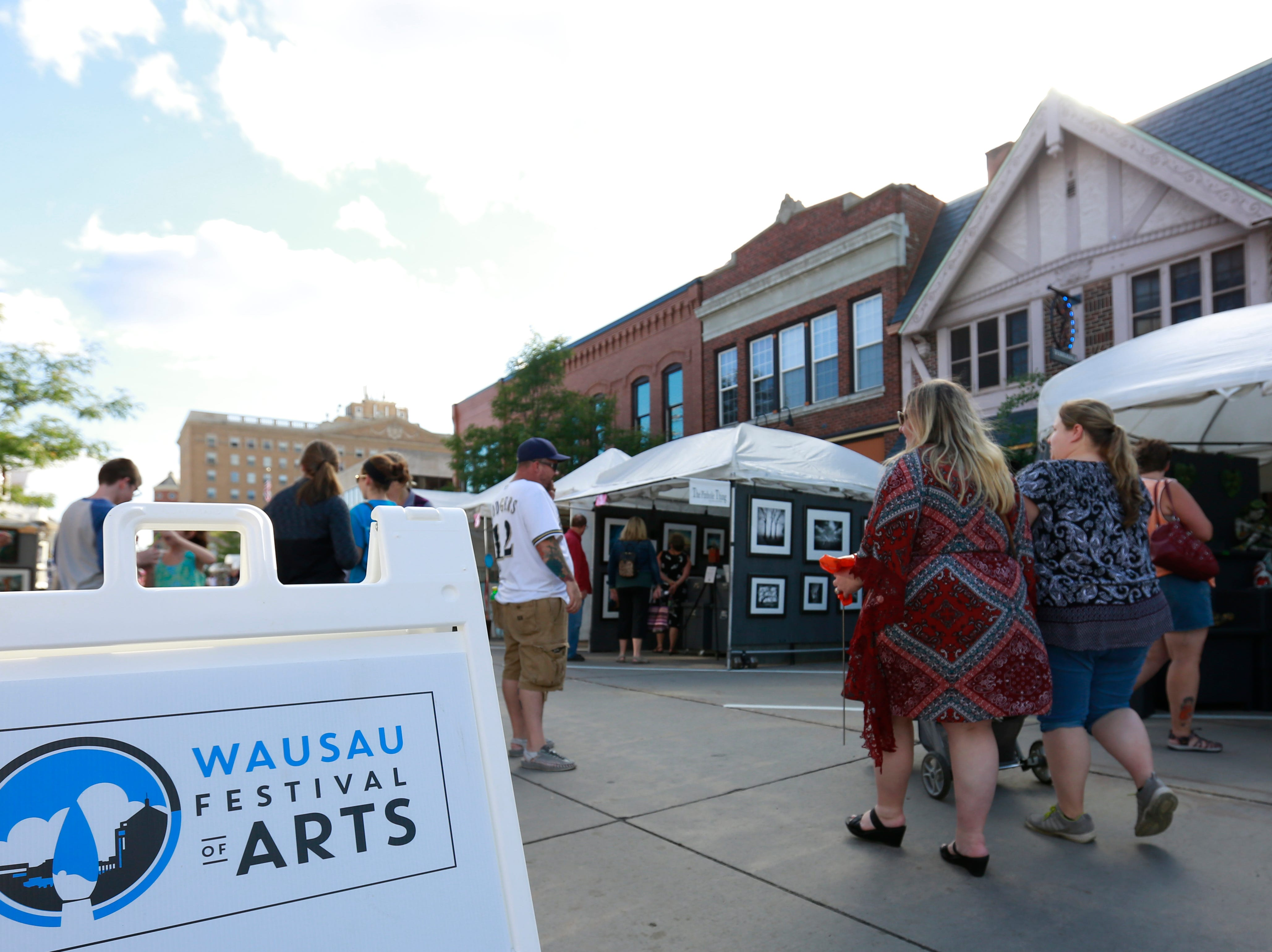 A Wausau Festival of Arts sign displays Saturday, Sept. 8, 2018, in downtown Wausau, Wis. T'xer Zhon Kha/USA TODAY NETWORK-Wisconsin