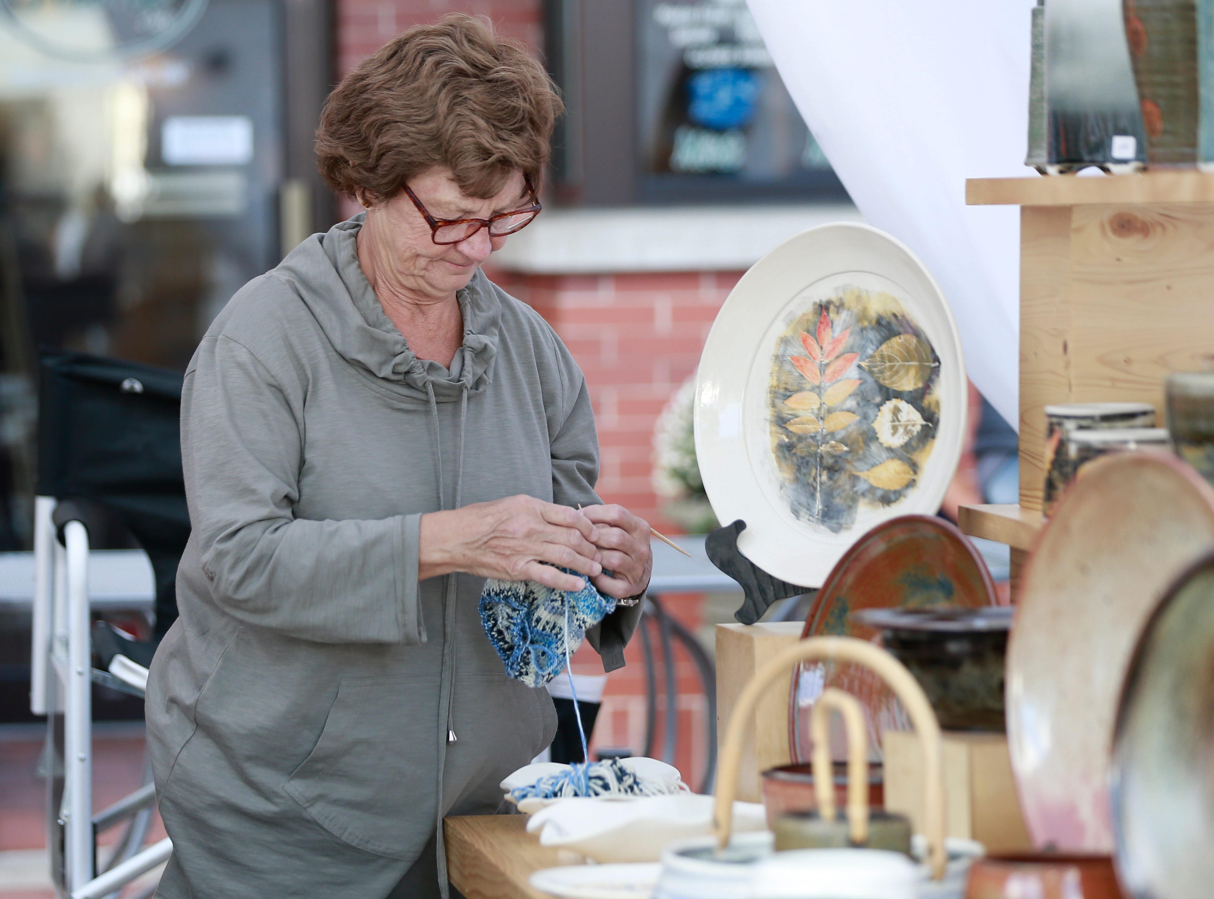 A vendor seen doing crochet during Wausau Festival of Arts event held Saturday, Sept. 8, 2018, in downtown Wausau, Wis. T'xer Zhon Kha/USA TODAY NETWORK-Wisconsin
