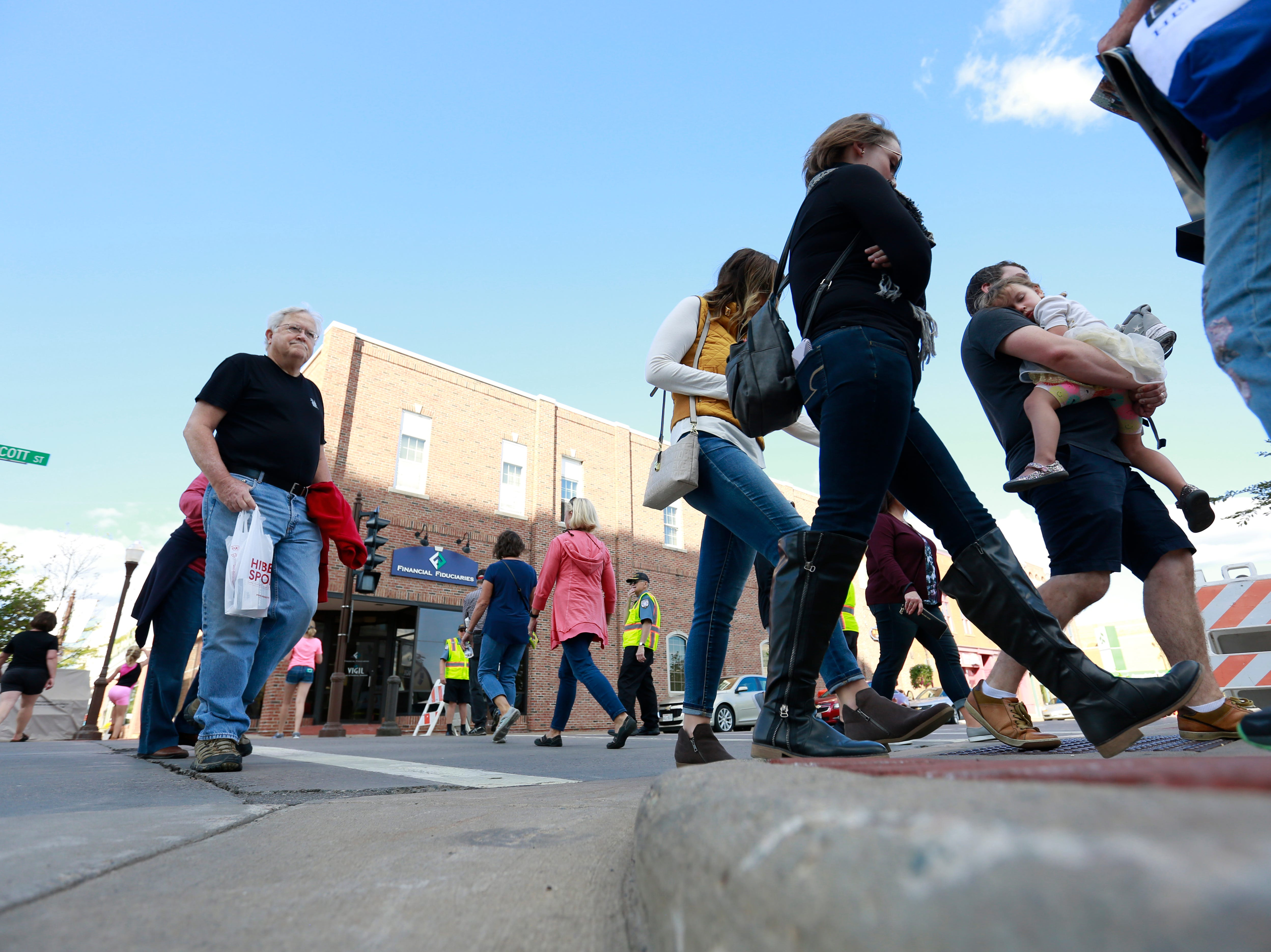 Pedestrians cross street at the corner of Scott Street and Third Street during Wausau Festival of Arts event held Saturday, Sept. 8, 2018, in downtown Wausau, Wis. T'xer Zhon Kha/USA TODAY NETWORK-Wisconsin