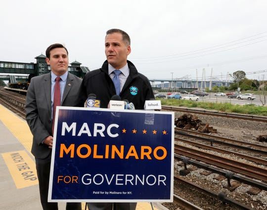 Marc Molinaro, the Dutchess County Executive and a candidate for New York State Governor, right, along with Assemblyman Kevin J. Byrne, are pictured at the Tarrytown train station for a press conference, Sept. 9, 2018.