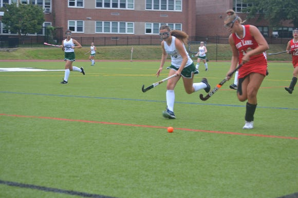 Pleasantville (in white) and Fox Lane (in red) play in first annual autism tournament final.