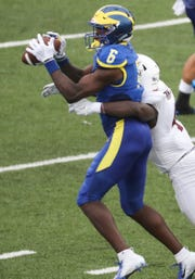 Delaware receiver Jamie Jarmon pulls in a 12-yard pass as he is hit by Lafayette's Yasir Thomas in the second quarter at Delaware Stadium.