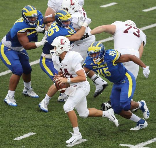 Delaware linebacker Armen Ware pursues Lafayette's Cole Northrup in the second quarter at Delaware Stadium.