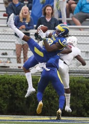 Delaware's Nasir Adderley takes away a pass intended for Lafayette's Nick Pearson in the fourth quarter of the Blue Hens' 37-0 win at Delaware Stadium Saturday.