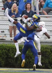 Delaware's Nasir Adderley takes away a pass intended for Lafayette's Nick Pearson in the fourth quarter of the Blue Hens' 37-0 win at Delaware Stadium in 2018.