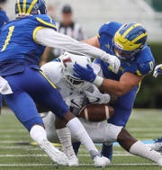 Delaware linebacker Troy Reeder (9) forces a fumble on Lafayette's Nick Pearson in the third quarter of the Blue Hens' 37-0 win at Delaware Stadium Saturday.