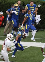 Delaware's DeJoun Lee sets up a Blue Hens score with a 35-yard run in the second quarter at Delaware Stadium.