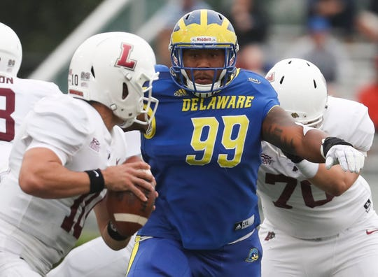 Delaware's Cam Kitchen pursues Lafayette quarterback Sean O'Malley in the first quarter at Delaware Stadium.