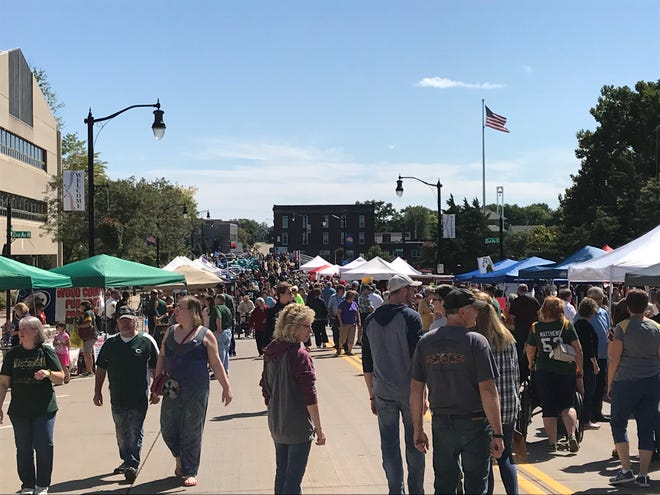 People walking along West Grand Avenue during the Downtown Grand Affair in Wisconsin Rapids.