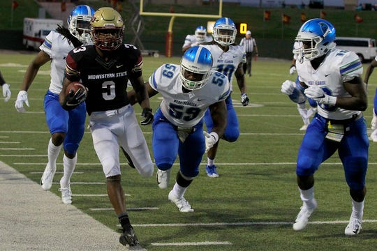 Midwestern State's Juwan Johnson steps out of bounds after a 25-yard gain Saturday against No. 2 West Florida.