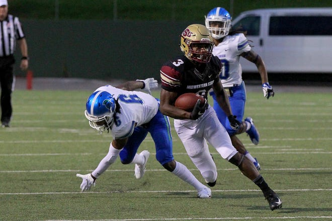Midwestern State's Juwan Johnson breaks a tackle Saturday night against West Florida.