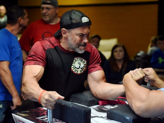 Cleveland's Richard Calero competes in a National Armwrestling League Qualifier held on Saturday at the Traveling Humidor in Zanesville. Calero won his division.