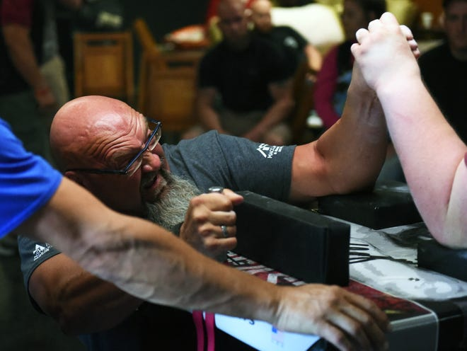 Indianapolis, Indiana native Tom Kitkowski competes during a National Armwrestling League Qualifier on Saturday at the Traveling Humidor in Zanesville.