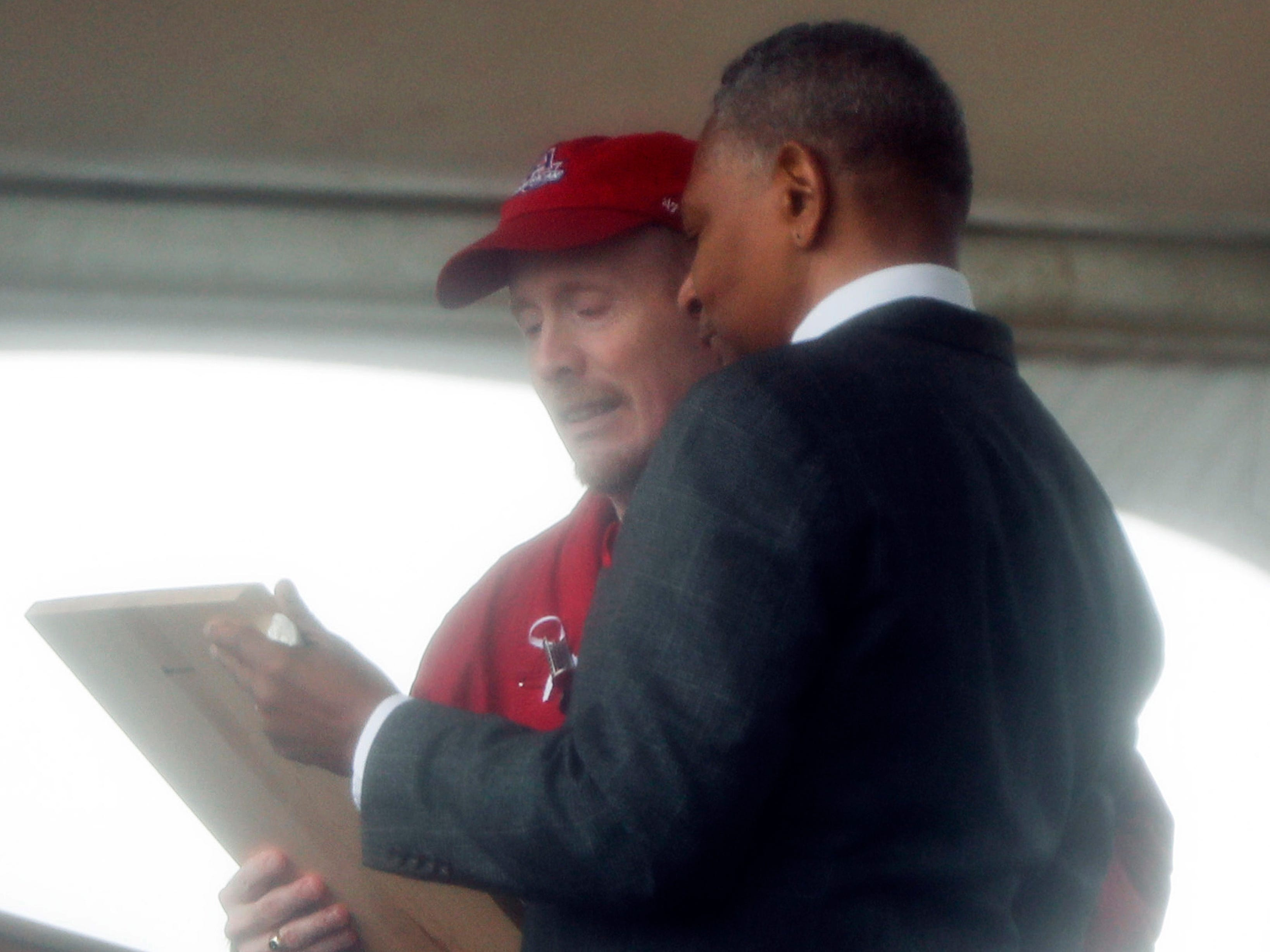 Calvin E. Wilson, right, brother of First Officer LeRoy Homer, a passenger on Flight 93, stands with Gordie Felt from the Families of Flight 93 as he presents him with a plaque at the dedication of the 93-foot tall Tower of Voices on Sunday, Sept. 9, 2018 at the Flight 93 National Memorial in Shanksville, Pa.