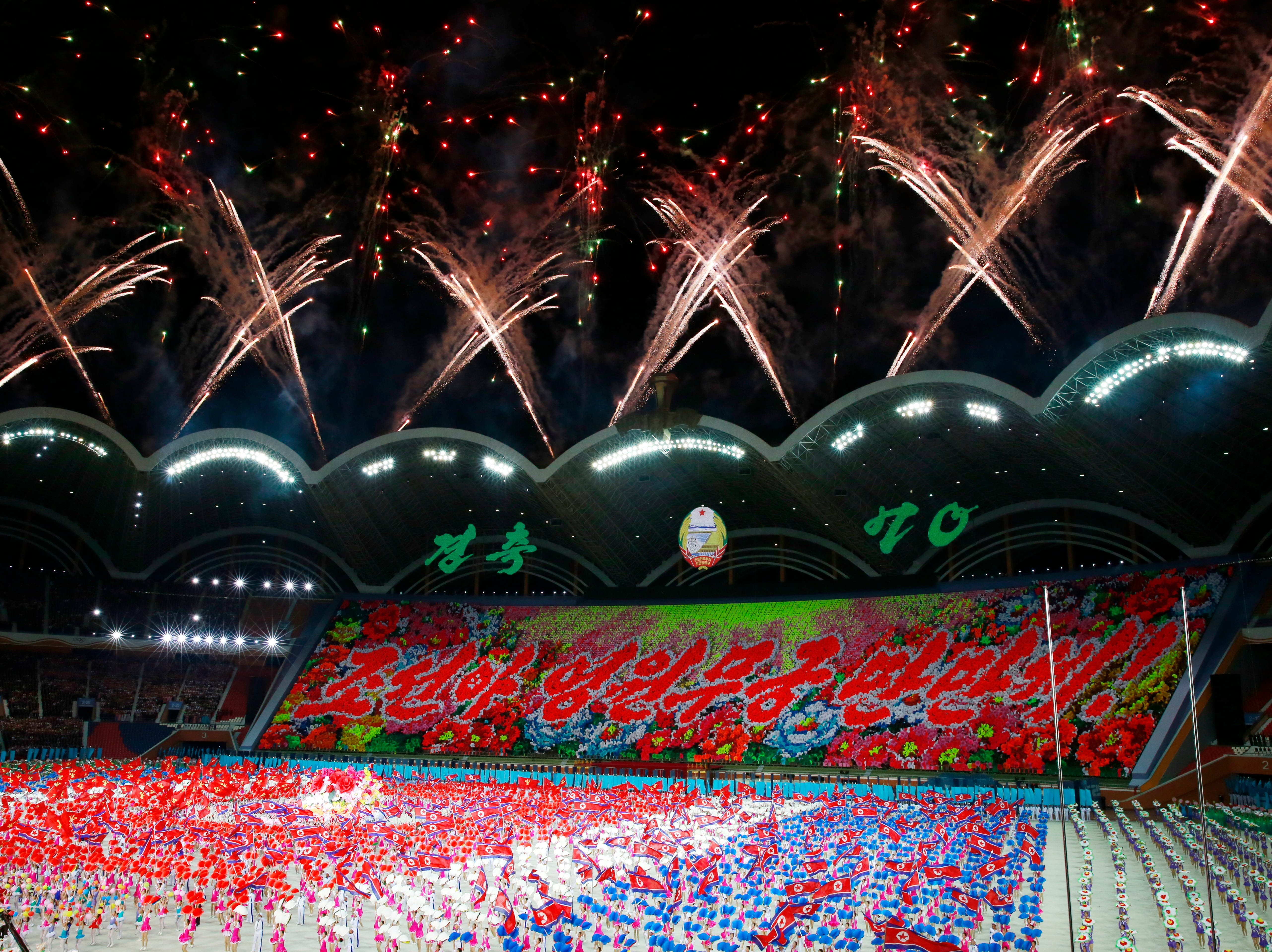 Fireworks erupt over the stadium during the Arirang Mass games celebrating the National Day and 70th anniversary of its Foundation in Pyongyang, North Korea on Sept. 9, 2018.