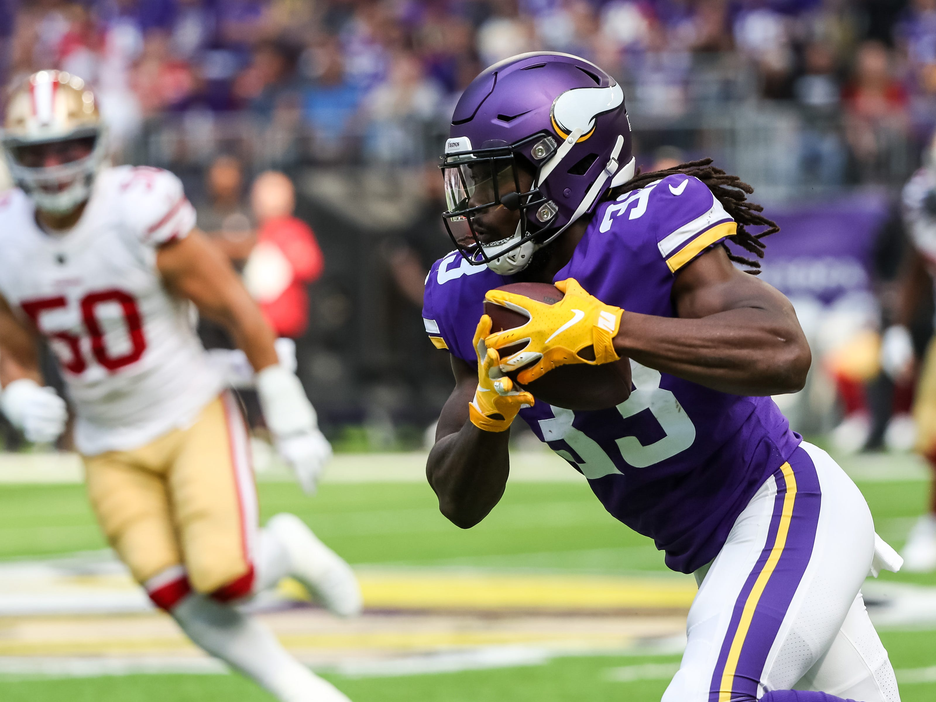 Minnesota Vikings running back Dalvin Cook carries the ball during the first quarter against San Francisco 49ers at U.S. Bank Stadium.