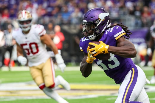 Minnesota Vikings running back Dalvin Cook carries the ball during the first quarter against San Francisco 49ers at U.S. Bank Stadium. - Packers QB Carted Off In Clash With Bears